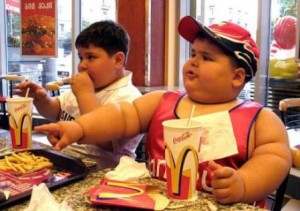 fat kids 300x211 How Come I Dont Weigh 300 Pounds?