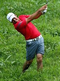 Jason Day hits out of the rough